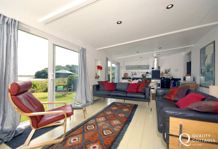 Laugharne spacious holiday studio with estuary views - open plan living space