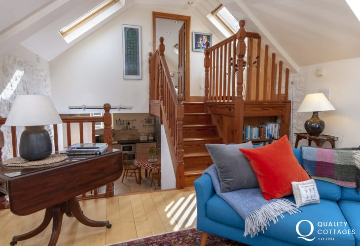 Carn Ingli Mountain holiday cottage - living room with mezzanine to master bedroom