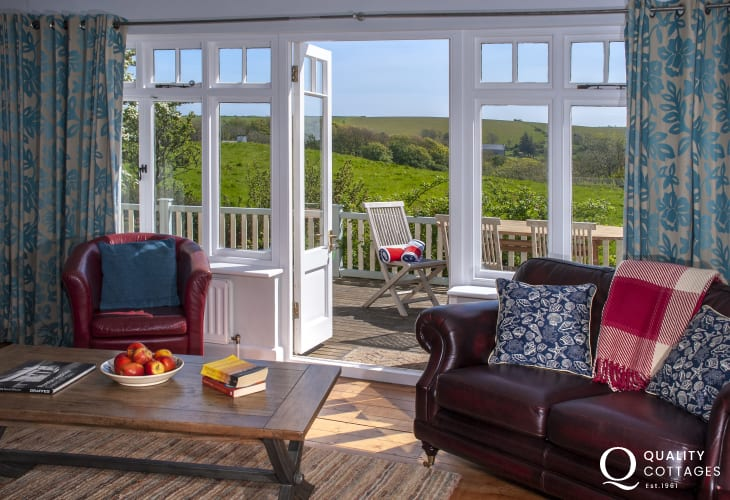 Manorbier family holiday home with french doors to the deck from the sitting room