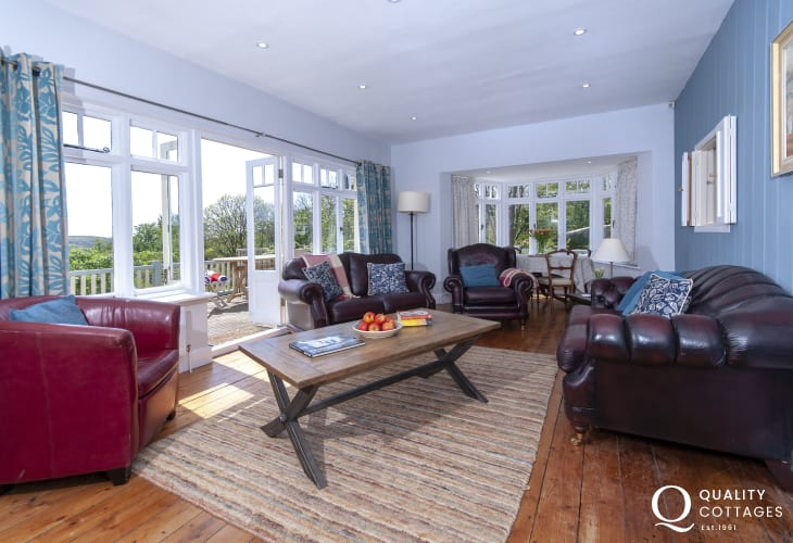 Pembrokeshire holiday cottage sitting room with french doors to south facing deck