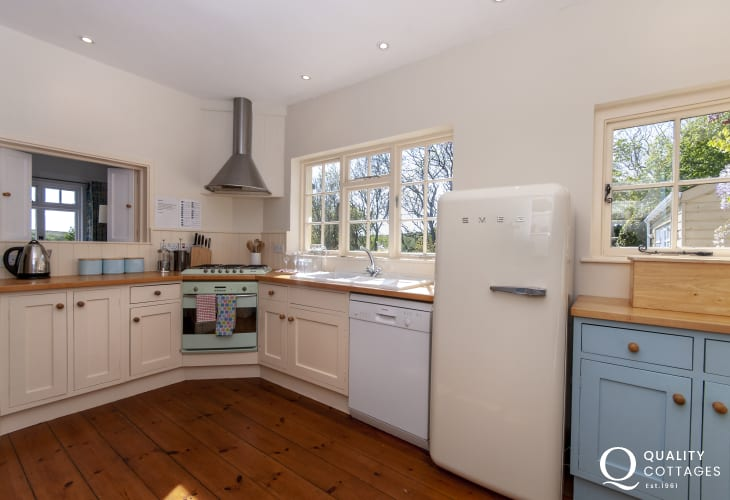Coastal holiday cottage - country style kitchen with hatch to the living room