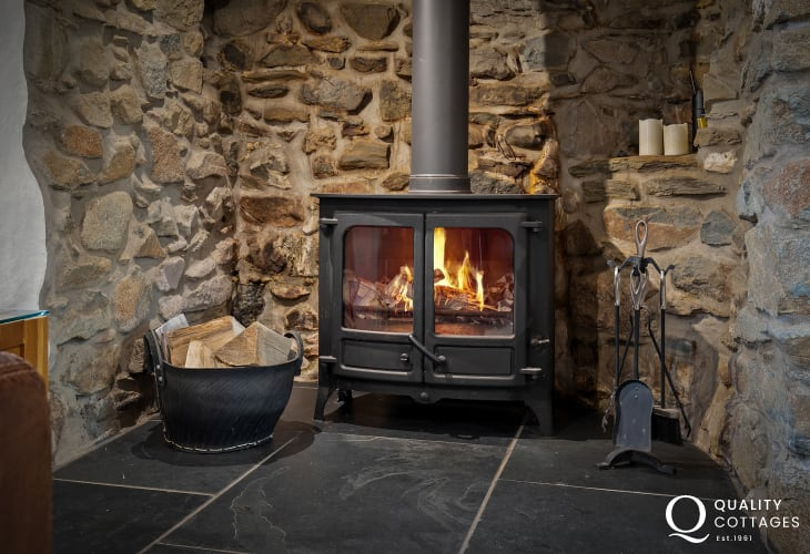 Lit Wood burning stove in Pembrokeshire holiday cottage