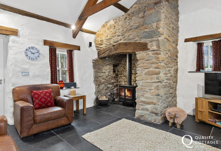 Sitting Room with lit wood burning stove and slate floors