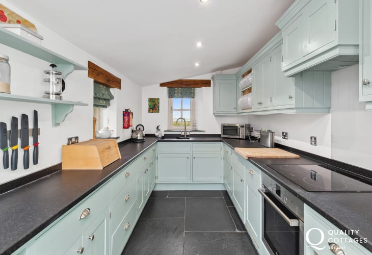 Duck egg kitchen with slate floors
