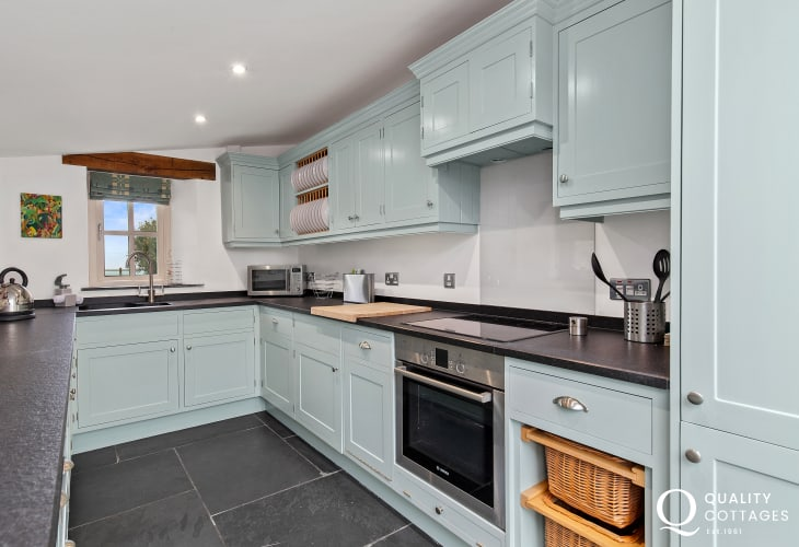 Duck egg shaker kitchen with slate floors