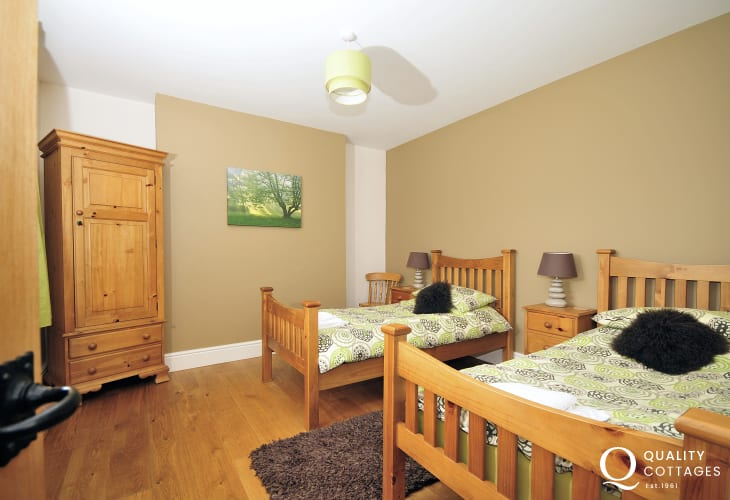 Twin bedroom in this family holiday home