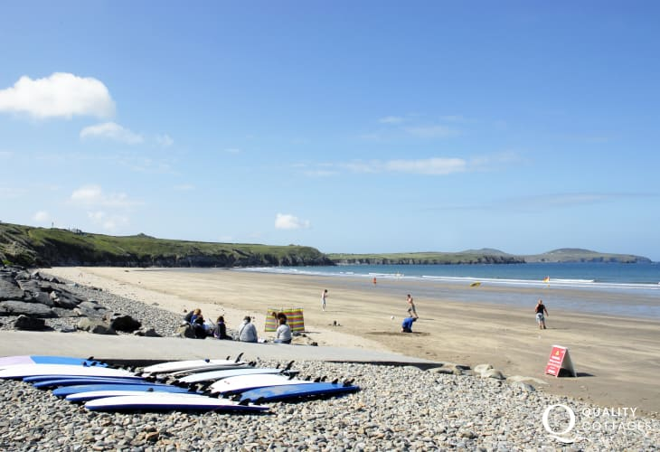 Whitesands Surf School hire wetsuits and surf boards down on the beach just 200 yds from Craig yr Awel