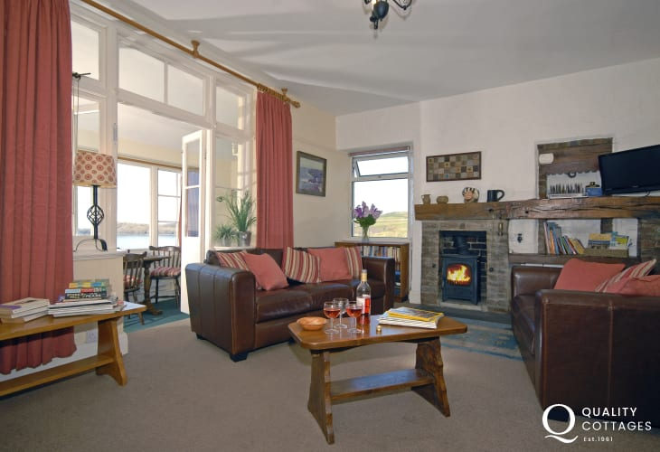 St Davids coastal holiday home - cosy lounge with sea views and log burning stove