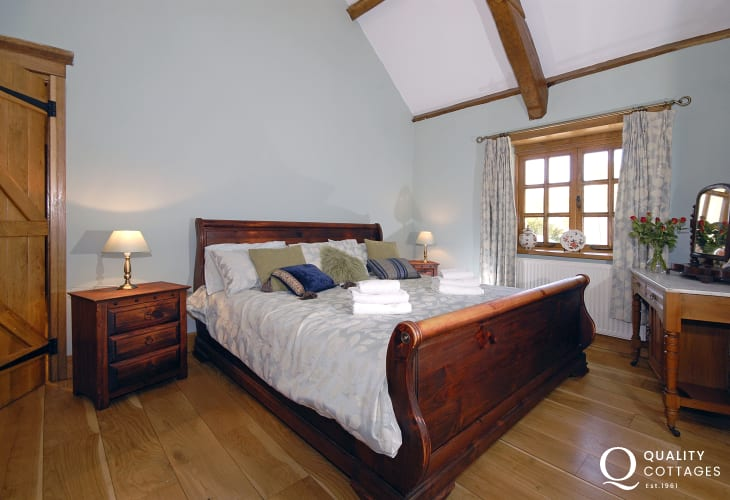 Preseli Hills holiday cottage master en-suite bedroom with 6 foot bed