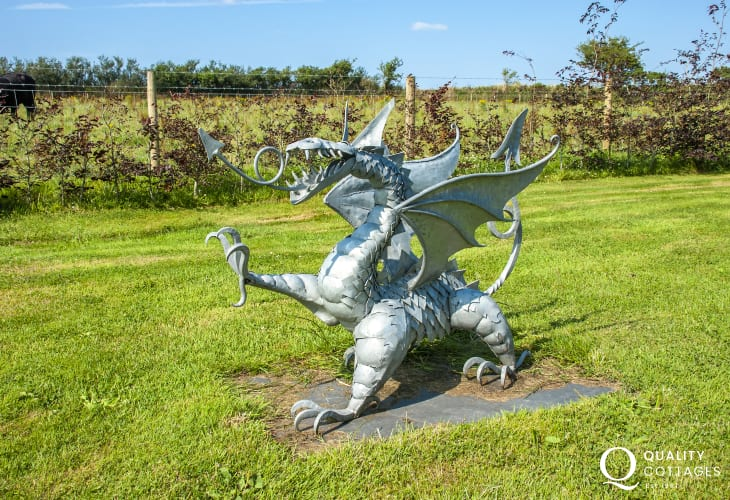 Welsh Dragon statue in the gardens at Yr Hen Glowty
