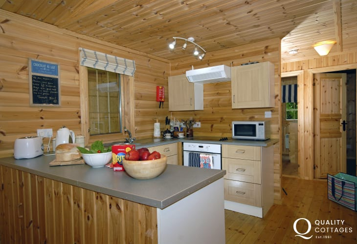 Newport self-catering log cabin - open plan fitted kitchen