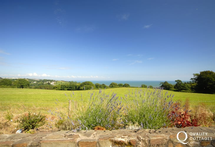 Fabulous views from the cottage across the headland to the sea and the Gower Peninsula beyond