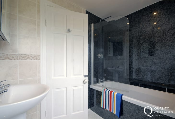 Family bathroom with shower over bath