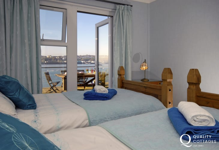 Pembrokeshire dog friendly waterside holiday cottage - twin bedroom with Haven Waterway views and decking
