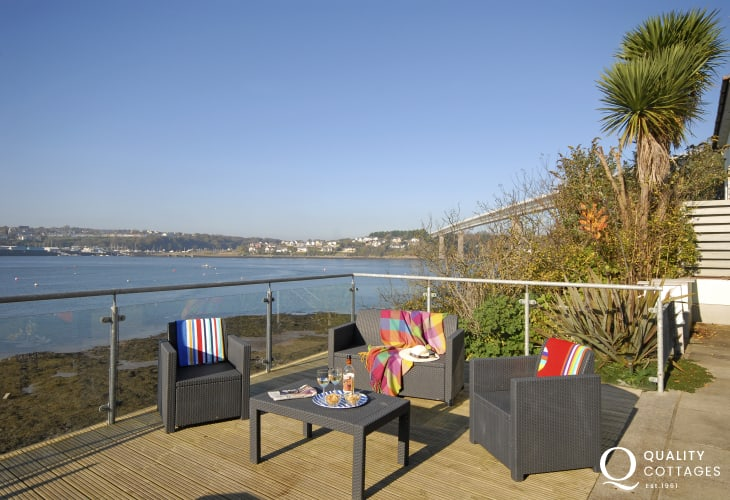 Panoramic Haven Waterway views from the large decked area of Beach Croft holiday cottage in Pembrokeshire