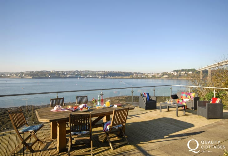 Enjoy panoramic Haven Waterway views from the large deck at Beach Croft holiday cottage in Pembrokeshire