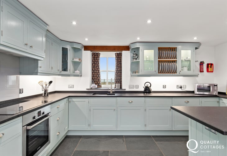Duck Egg Shaker Kitchen with slate flooring