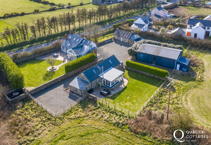 Drone views of temple barn, cottage and house