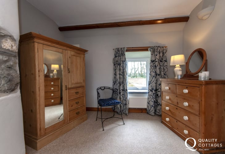 Coastal cottage Pembrokeshire - master with antique pine furniture