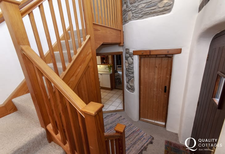 Abermawr holiday cottage entrance hallway with Oak staircase