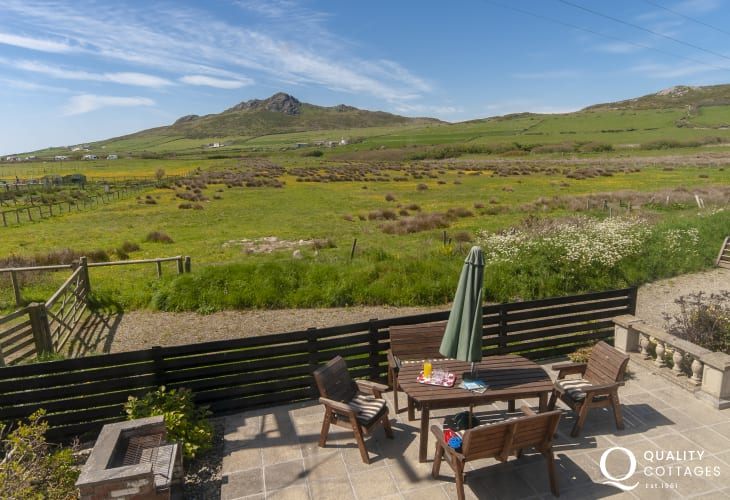 Views over the terrace to Carn Llidi mountain from the living room