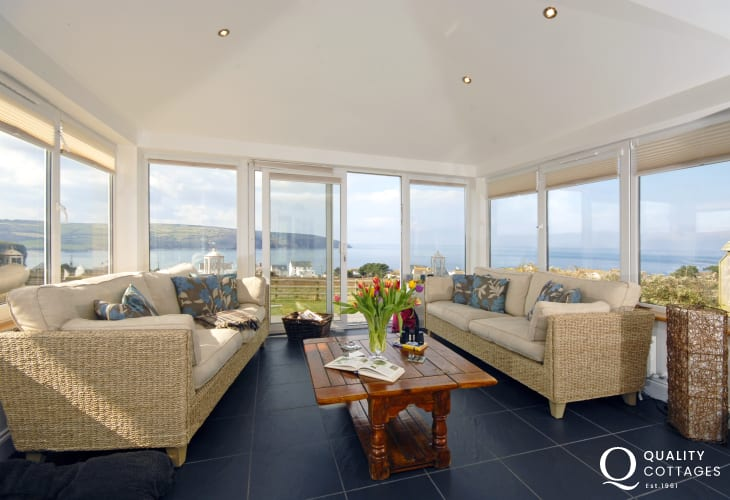 Cardigan Bay dolphin spotting - relax in the comfortable sunroom with views over the coast