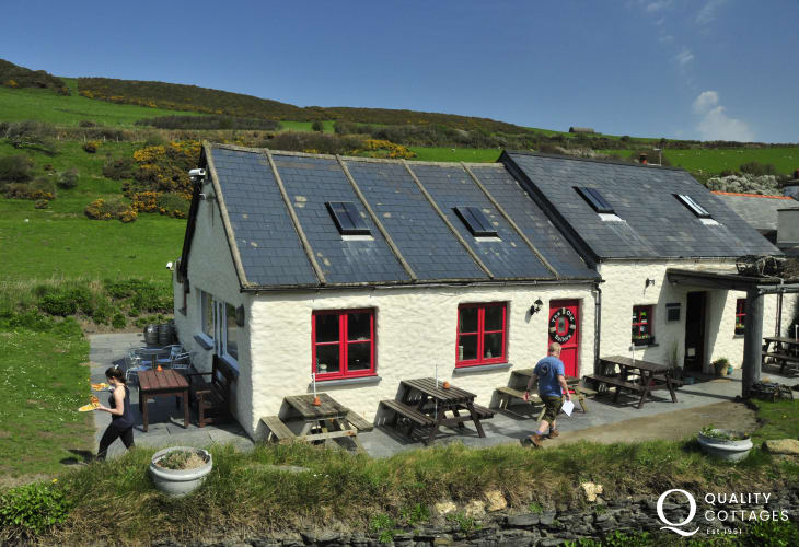 Try the Old Sailors Inn - a cosy restaurant and dog friendly beer garden overlooking the beach