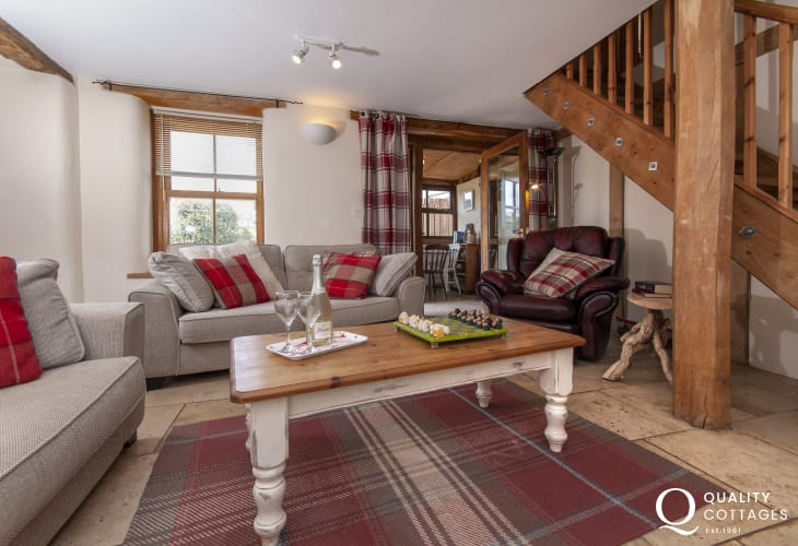 Pembroke town cottage to rent - sitting room with wifi, underfloor heating and oak beams