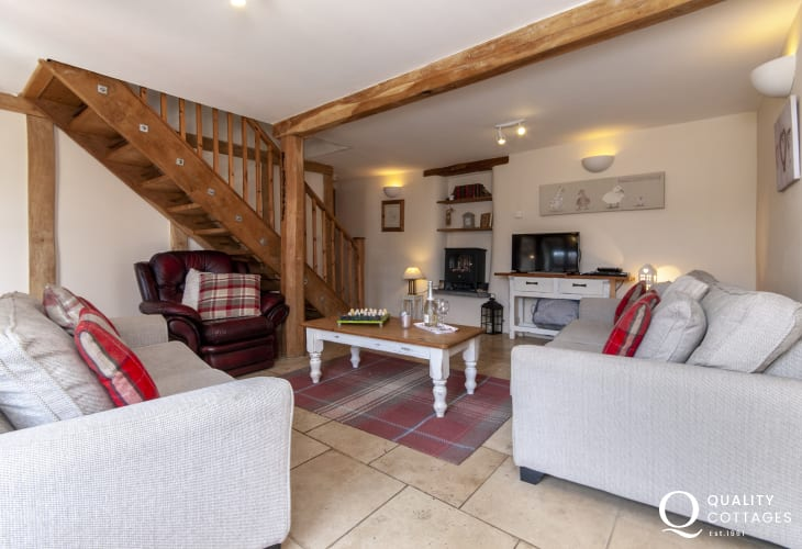 Cosy Pembrokeshire holiday cottage - sitting room with wifi, underfloor heating and electric fire