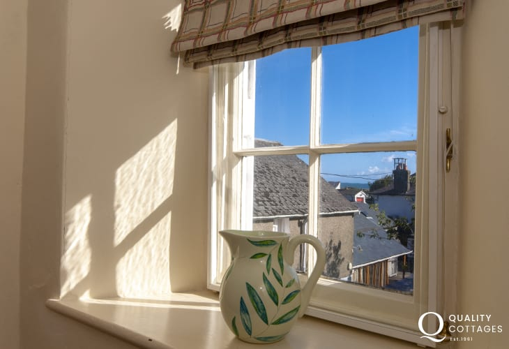 Cardigan Bay holiday home in Aberaeron - landing window with glimpses of the sea