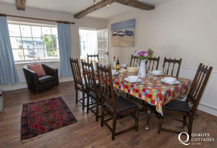 Aberaeron harbour holiday home - dining room with doors to sun room and gardens