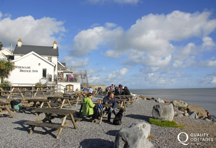 The Wisemans Bridge Inn is a 16th century pub over looking the beach - a great spot for food and drink