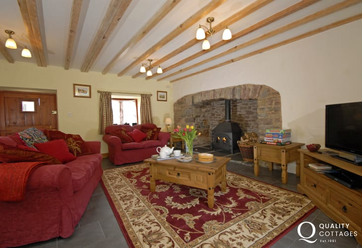 Laugharne holiday cottage - sitting room with WiFi and wood burning stove