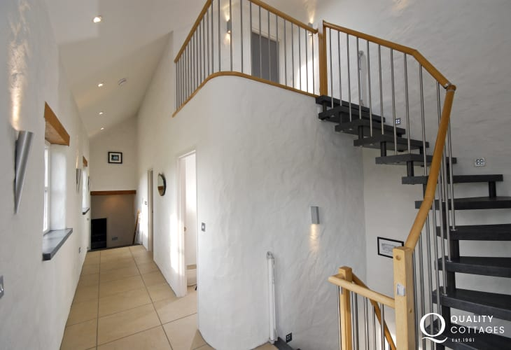 North Pembrokeshire barn conversion - hallway with spiral staircase