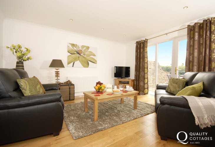 Pembrokeshire holiday home near the coast - lounge area with patio doors to the terrace