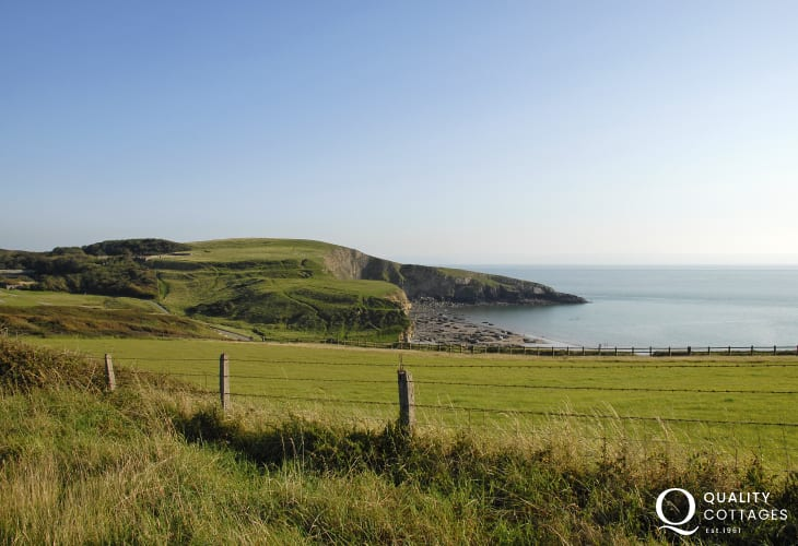 Enjoy fabulous views over the Glamorgan Heritage Coast from the grounds at Slade Cottage