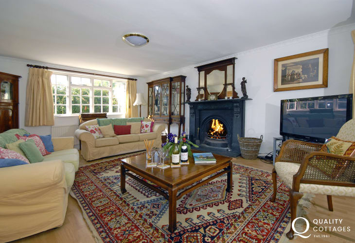 Welsh farmhouse holiday sleeps 8 - lounge with open fire