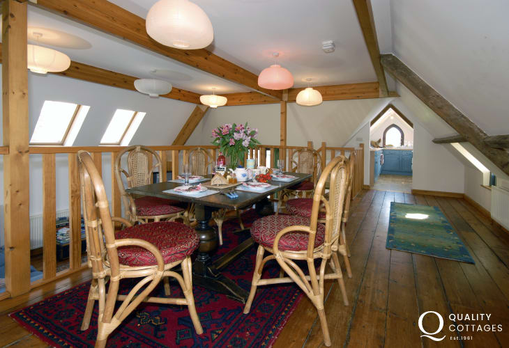 Dunraven Beach holiday cottage - open plan galleried dining area