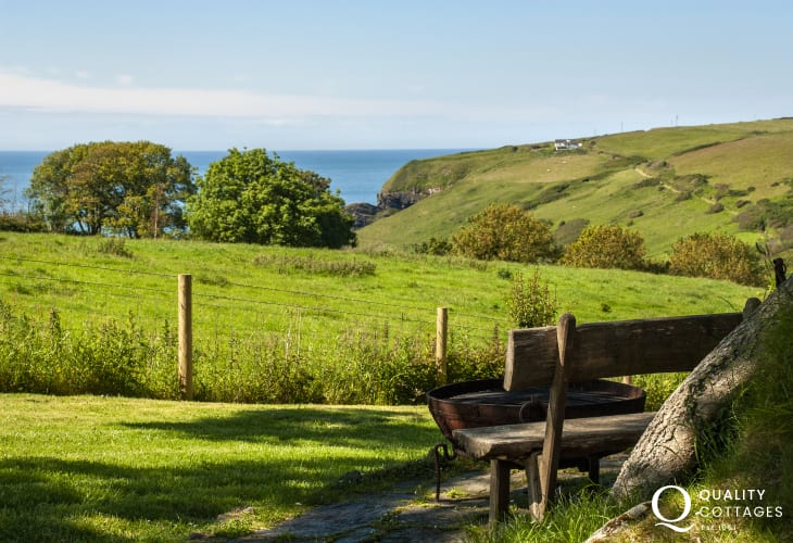 Holiday cottage patio with views to Ceibwr Cove, National Trust