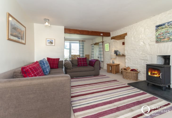 Cardigan Bay holiday house - family sitting/games room with wood burning stove