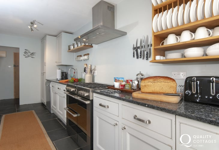 Self-catering riverside cottage in South Pembrokeshire - modern kitchen with slate floor