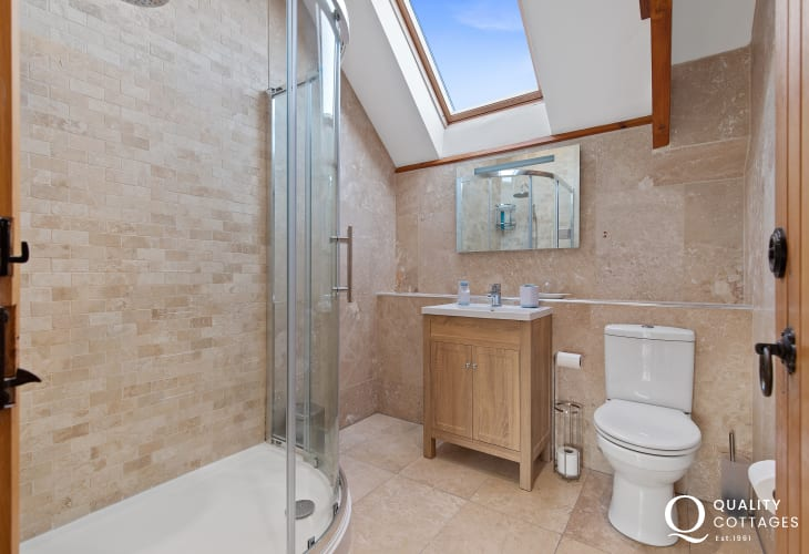 shower room with vanity storage and velux