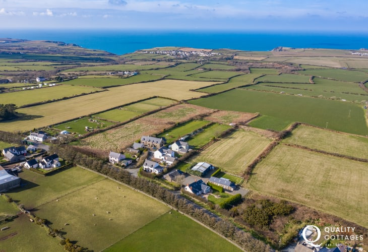 Aerial view of Temple Cottage, Temple Barn and Temple House with views out over Pembrokeshire coast