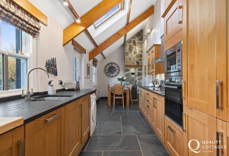 Oak kitchen with slate floors