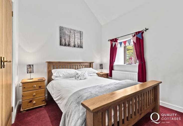 Coracle Centre a must to visit when staying in Kite Cottage for holiday double bedroom bedside cabinet with lamp