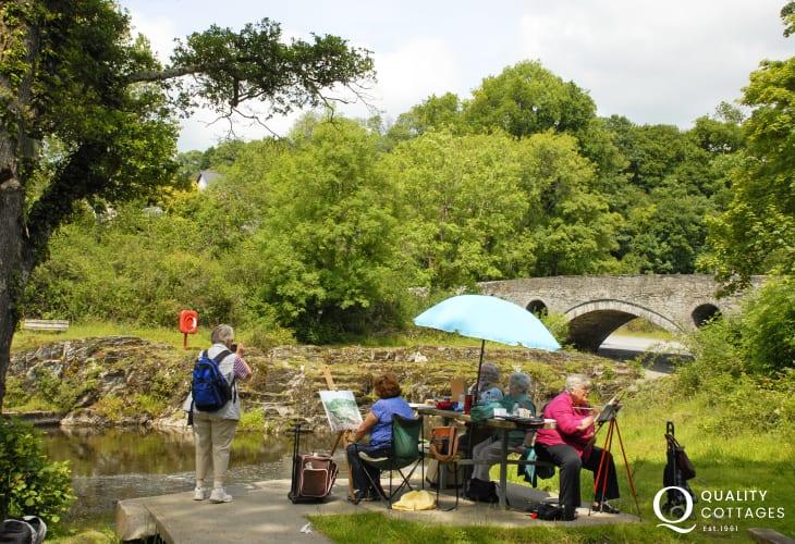 Budding artists on the Teifi River in Cenarth