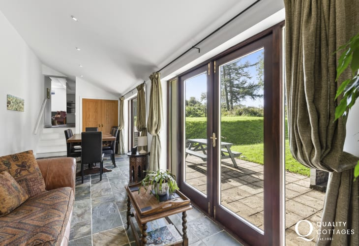 Ceredigion coast path cottage holiday dining seating area French doors opening onto rear garden