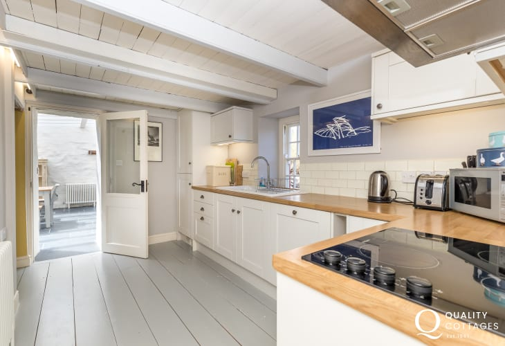 Kitchen spacious with wooden worktops, electric oven double farmhouse sink