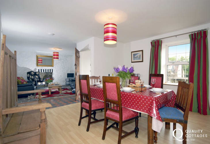 Newgale self catering holiday home - open plan lounge/diner with wood burning stove