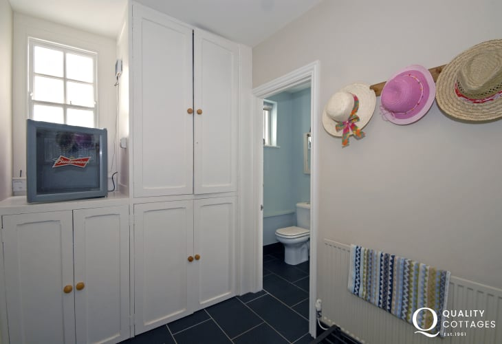 Large utility room with double walk in shower room